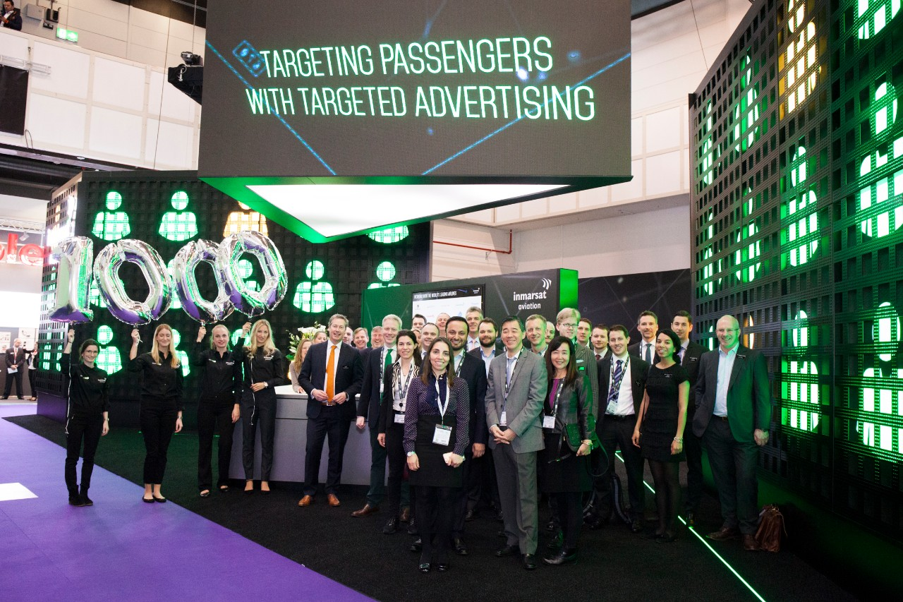 Staff from Inmarsat Aviation and its partners celebrate the milestone of 1,000 aircraft in backlog for Inmarsat's next-generation inflight broadband at Aircraft Interiors Expo (AIX) in Hamburg, Germany.