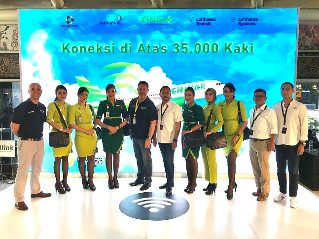 Inmarsat and Mahata executives, with Citilink cabin crew, celebrate the go-live of GX Aviation inflight broadband on the Indonesian low-cost carrier's first aircraft.