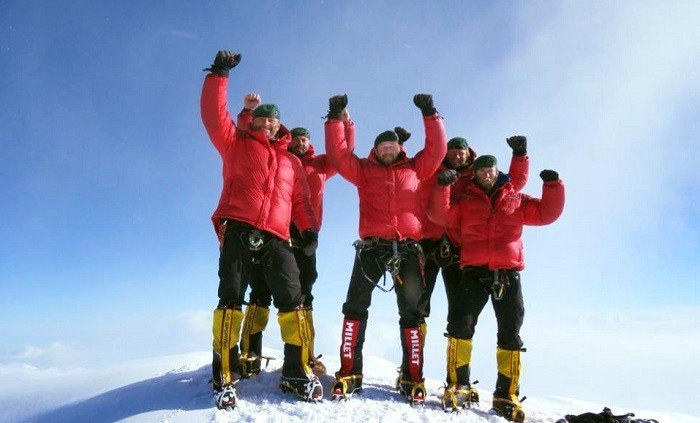 65 Degrees North Team celebrating on the Mount Denali summit